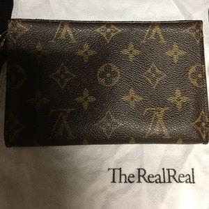 Louis Vuitton Petite Bucket bag cosmetic pouch